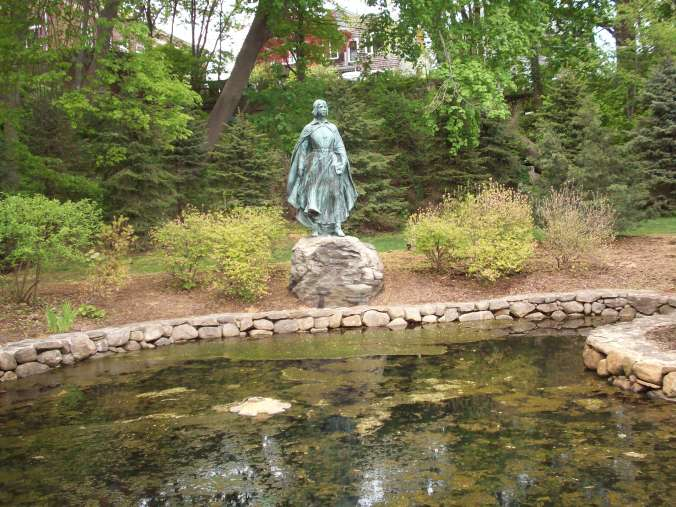 The Pilgrim Maiden, a bronze statue erected in 1922 in honor of the women of the families who founded Plymouth (then known spelled Plimoth)