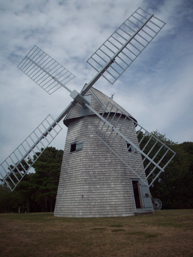 An angled front view of Godfrey Windmill in Chatham, MA