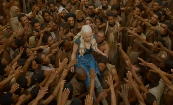 "Danaerys Targaryen (Emilia Clarke) is embraced by the slaves she liberated on ""Game of Thrones."""